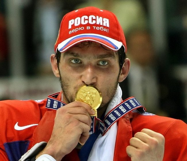 Alexander Ovechkin kisses his medal after his team defeated Candada 5-4